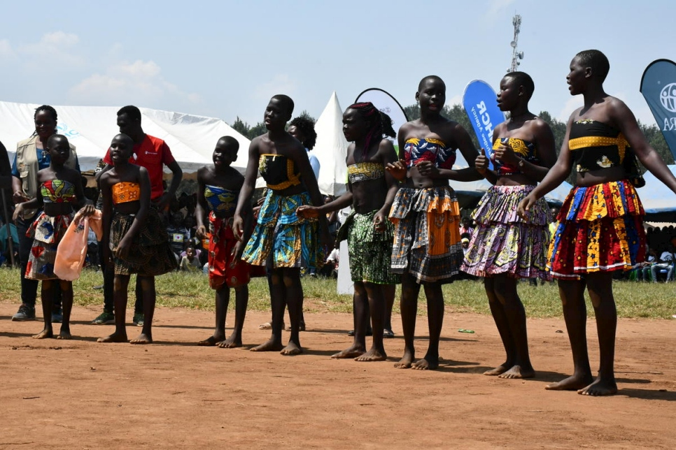 South Sudanese refugees perform a cultural dance during World refugee day celebrations in Rwamwanja settlement, Uganda.