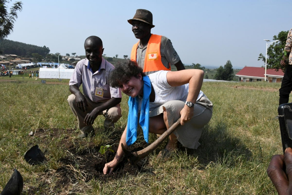 Kemlin Furley, Head of UNHCR External Relations and Communication plants a tree at a primary school in Rwamwanja settlement, Uganda.