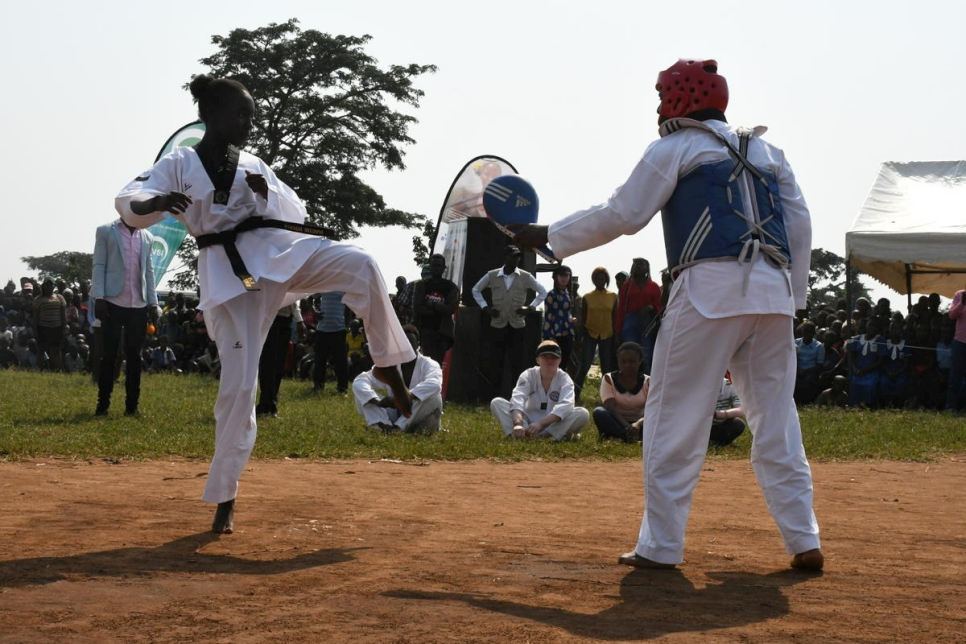 South Sudanese refugee, Flora who also leads the refugee Taekwondo team in Kampala, Uganda performs at the World Refugee Day event in Rwamwanga settlement, Uganda.