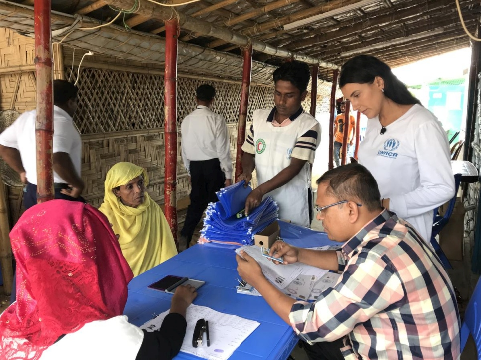 Bangladesh. UNCHR Associate Registration Officer Thais Severno helps register Rohingya refugees