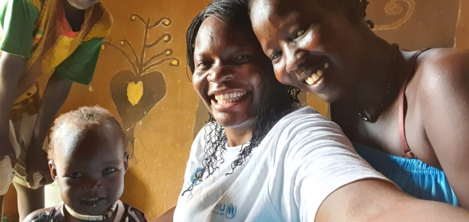 Millicent takes a selfie with a South Sudanese refugee mother and her child in Gambella, Ethiopia.
