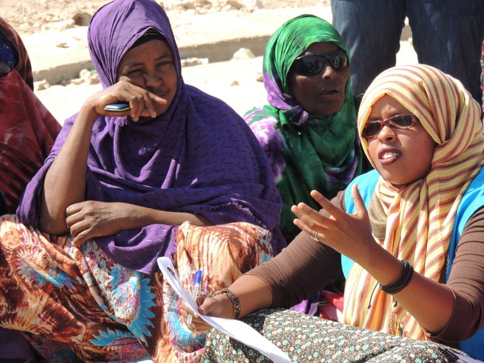 Deka (right) speaks with displaced women during a field visit in Hargeisa, Somaliland.