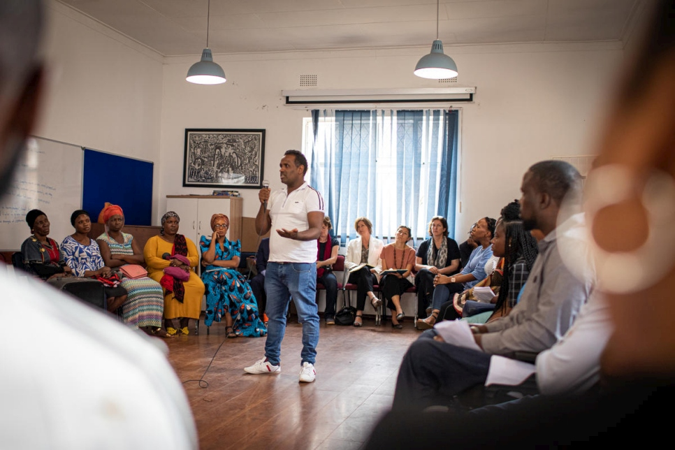 Wasenu, a refugee from Ethiopia, addresses Grandi at a meeting in Hillbrow, Johannesburg, in South Africa.
