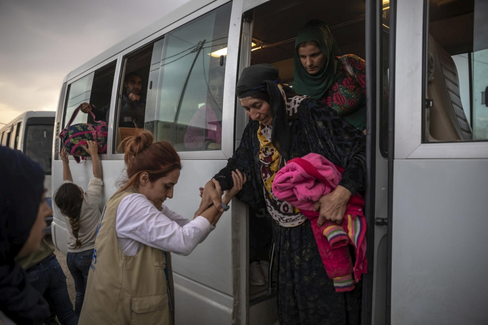 Iraq. Syrian refugees fleeing military campaign receive aid at UNHCR camp