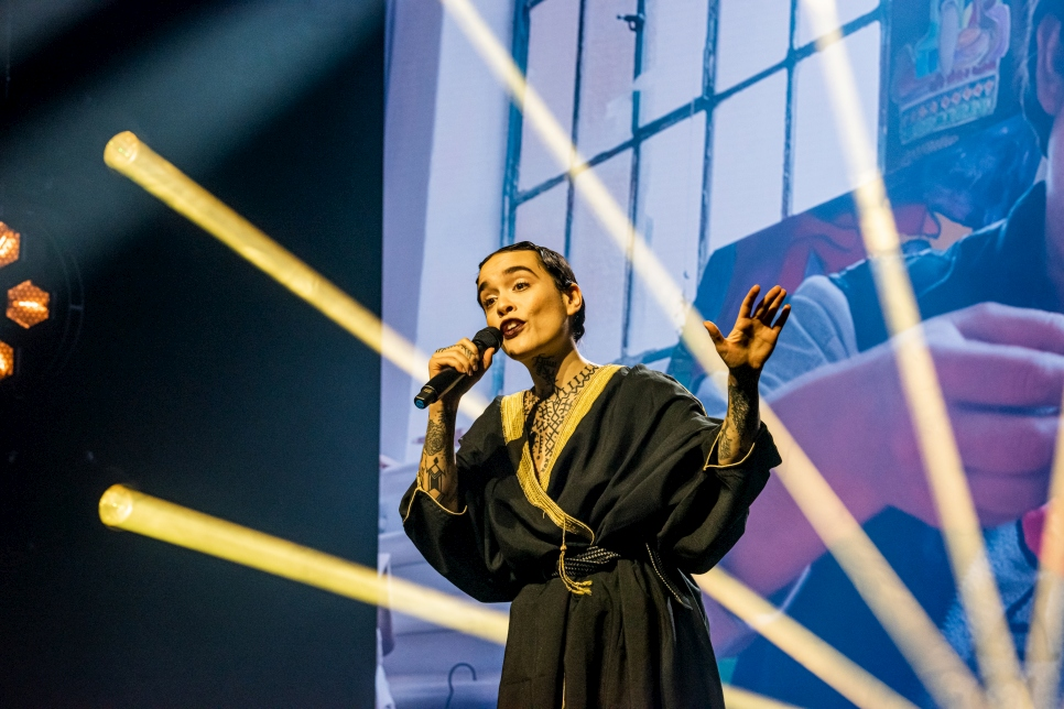 Swiss-Algerian singer-songwriter Amina Cadelli, aka Flèche Love (Arrow Love), performs her song, Sisters during the ceremony.