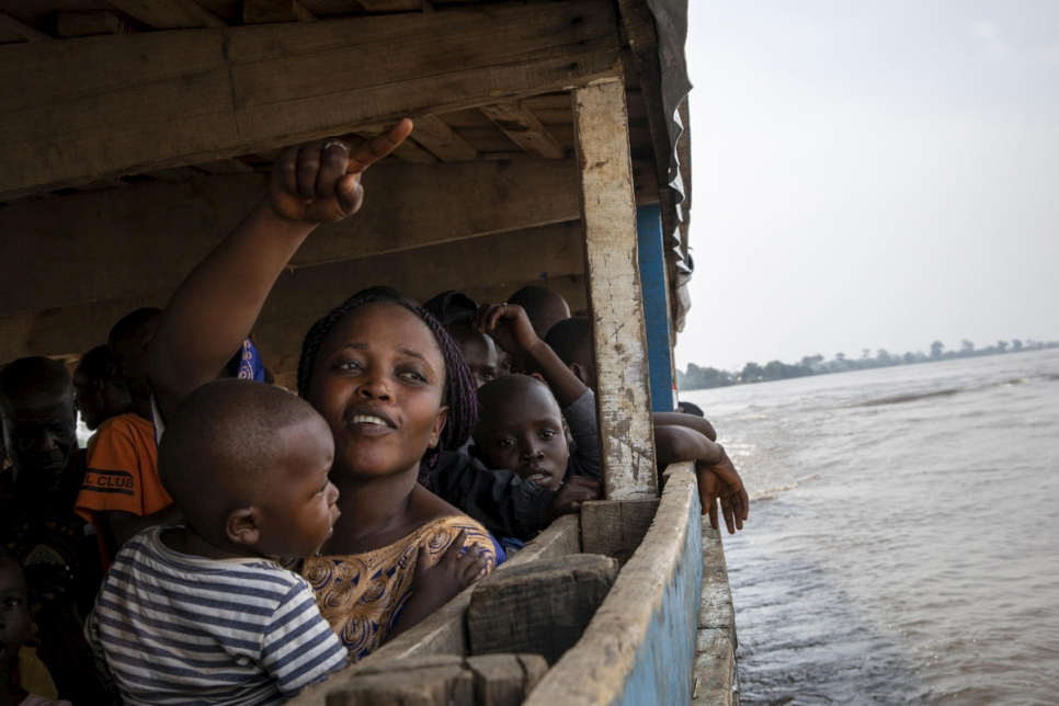 Central African Republic. A returnee points Bangui on her way back