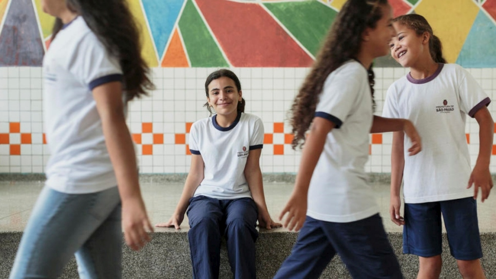 Syrian refugee Hanan Dacka (center), 12 years-old, plays with newly-made Brazilian friends Maria Luiza de Sousa, 12, Julia Vanderlei, 12, and Andressa Rabasco, 12, at the Duque de Caxias Municipal School, in the Glicerio neighborhood of downtown Sao Paulo, Brazil.