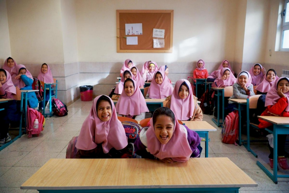 Iran. Afghan refugee sisters go to school for the first time