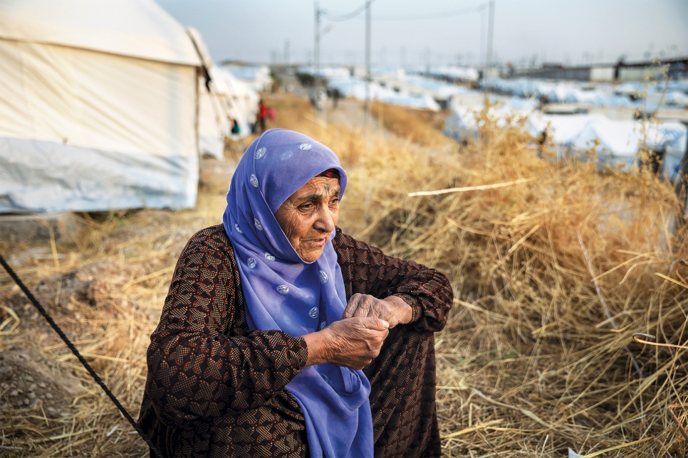 Seventy-year-old Guzeh Mustafa sits outside a shelter at Bardarash camp in Duhok, Iraq. She arrived from north-east Syria with six family members in October 2019 and is in need of medical assistance