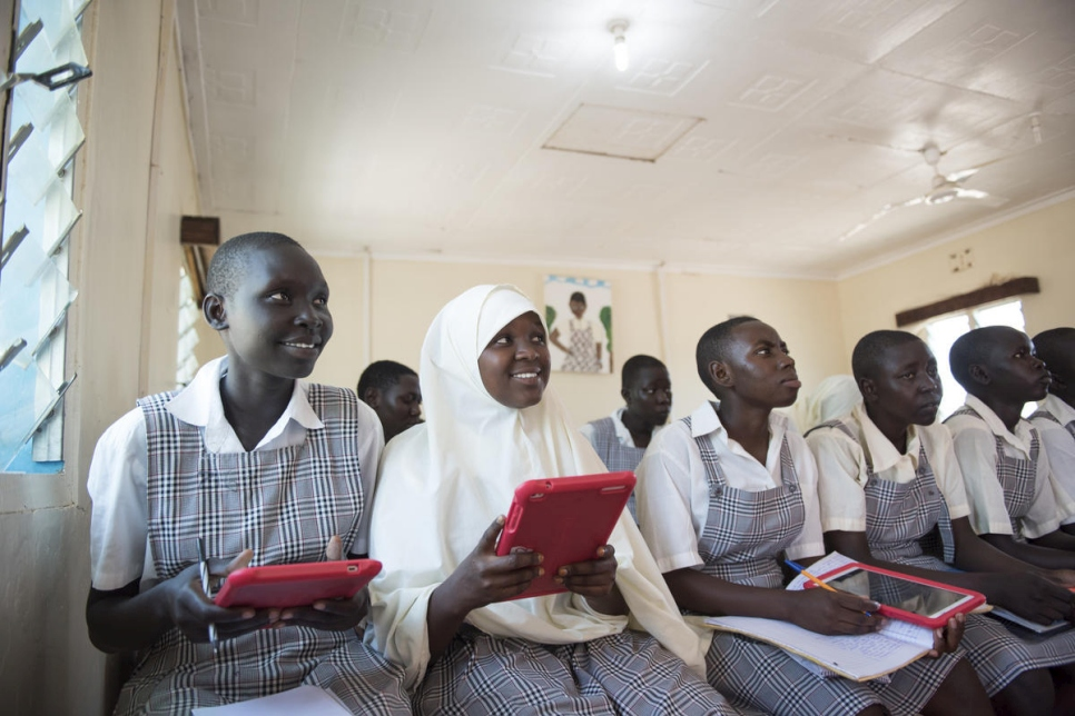 Kenya. Mary and Mumina use tablets in Class 8 at Angelina Jolie School