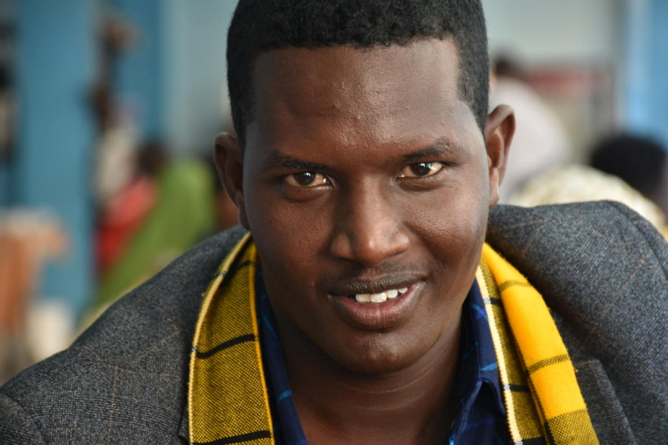 Abdirashid Mohumed, 24, smiles as he arrives in Dire Dawa, Ethiopia. He has returned home after being in exile for five years.