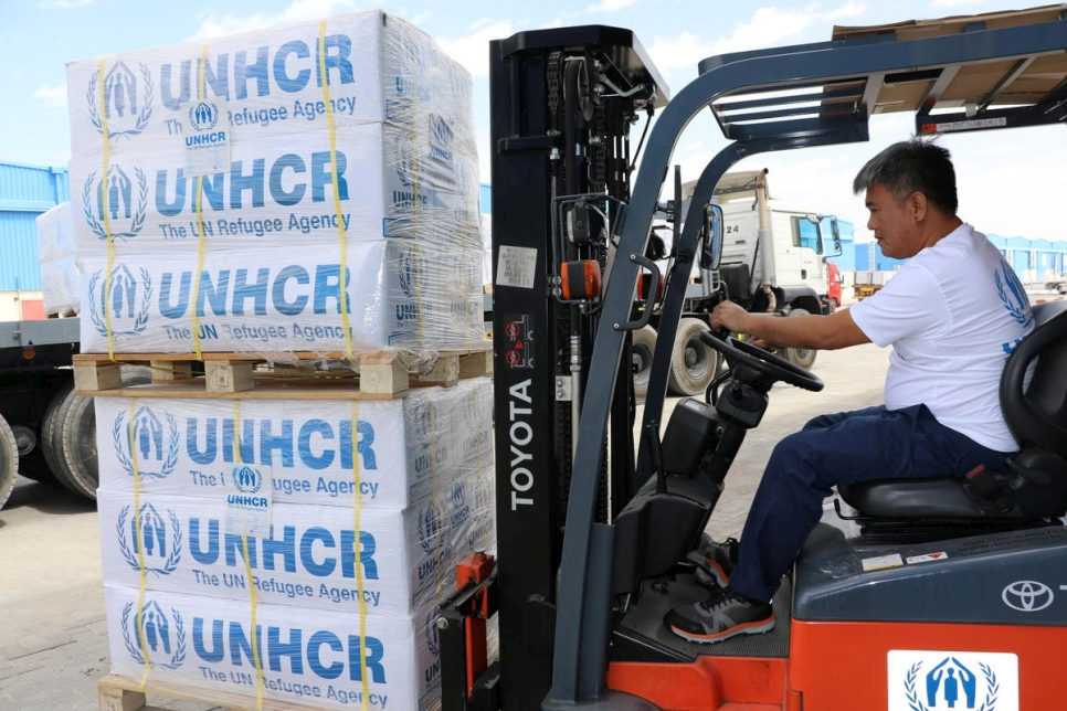 United Arab Emirates. Staff at UNHCR's global stockpile in Dubai prepare an emergency shipment of supplies including blankets, jerrycans and bed mats to be airlifted from Dubai to Chad