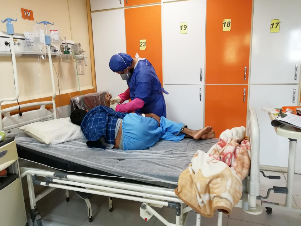 Iran. Moheyman, an Iraqi refugee nurse, treats patients suspected of having contracted the COVID-19 in the south of Iran.