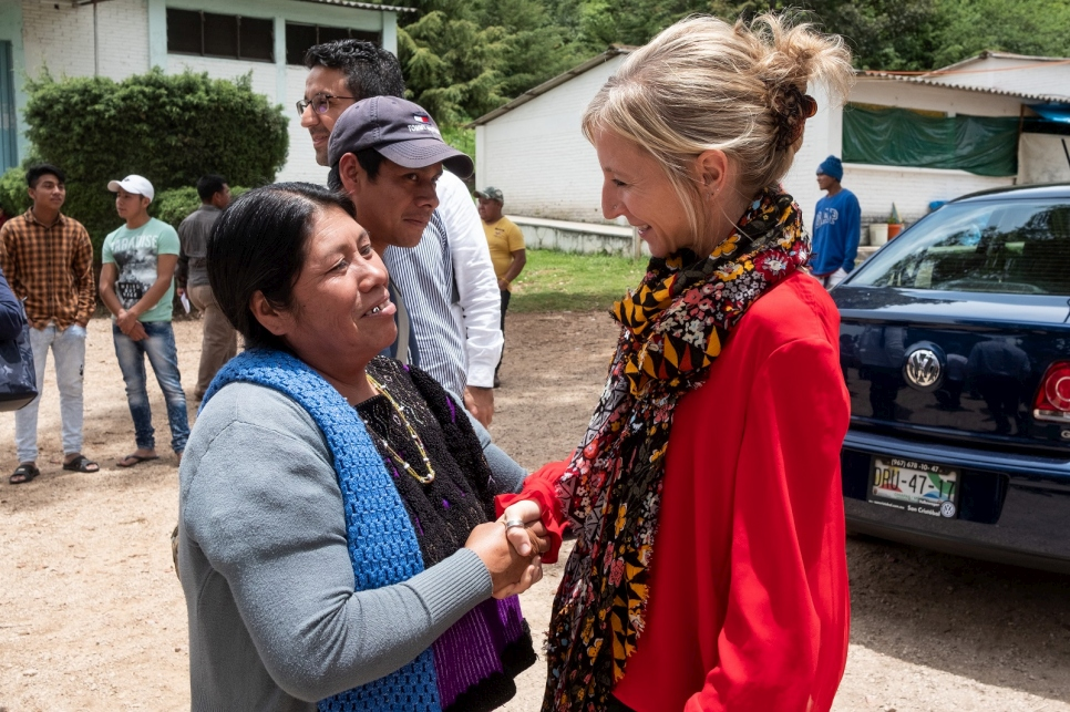 Alexandra Bilak (right), director of IDMC, greets an internally displaced woman at a camp in Chiapas, Mexico, in 2019.