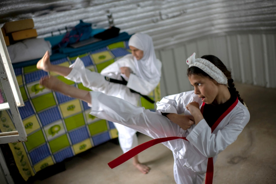 Syrian sisters practice Taekwondo at their home in Azraq refugee camp, Jordan, during lockdown.
