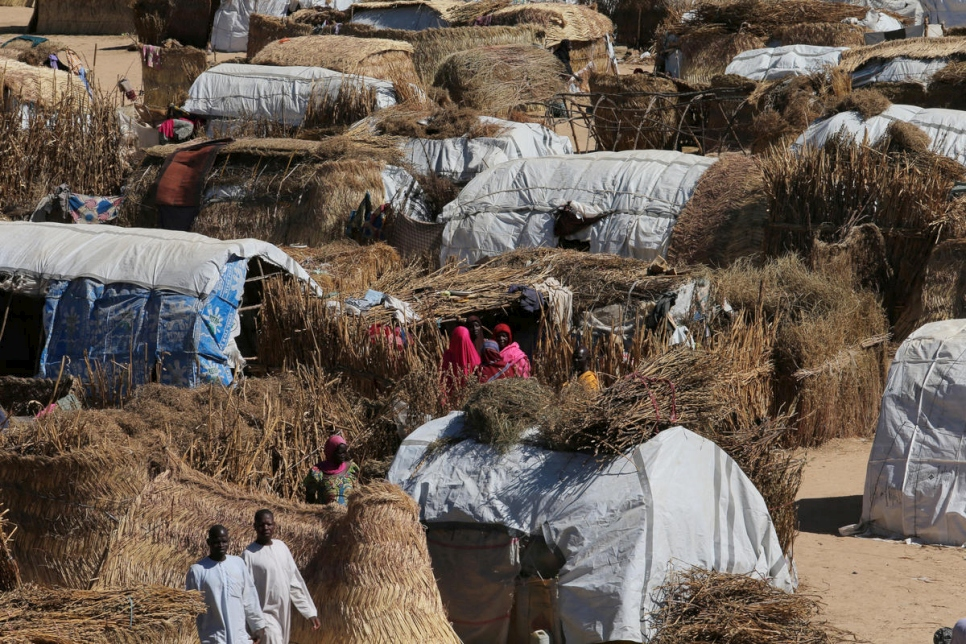 Nigeria. Thatched homes at the Muna Internally displace peoples camp in Maiduguri, Nigeria