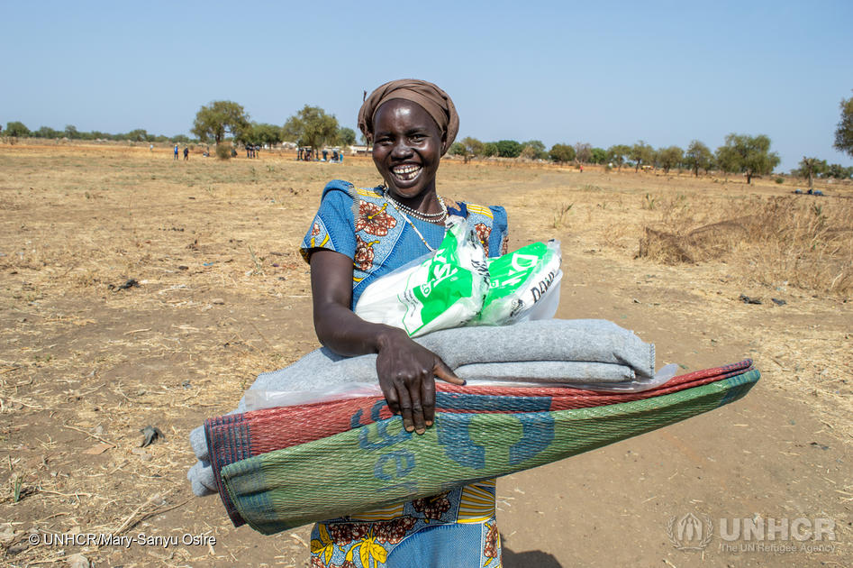 A woman from South Sudan's refugee-hosting community collects her UNHCR core relief items in Bunj, Maban county.