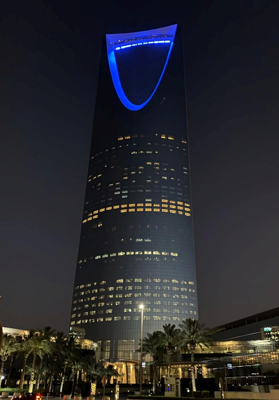 Saudi Arabia. The Kingdom Tower lights in UN blue for World Refugee Day 2020