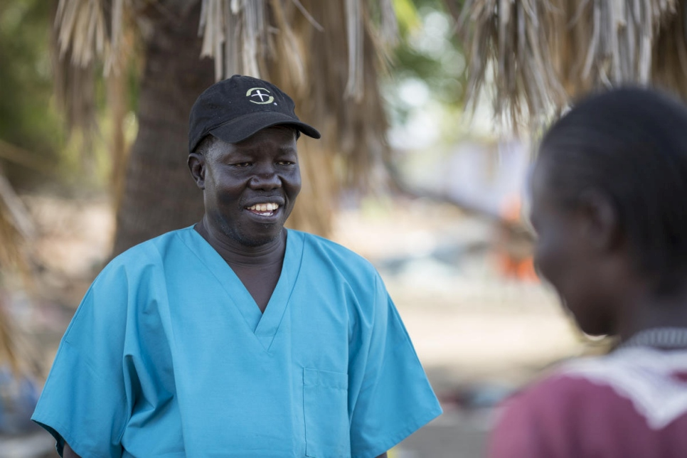 Dr. Evan Atar meets with patients outside the Bunj hospital in Maban County, South Sudan.