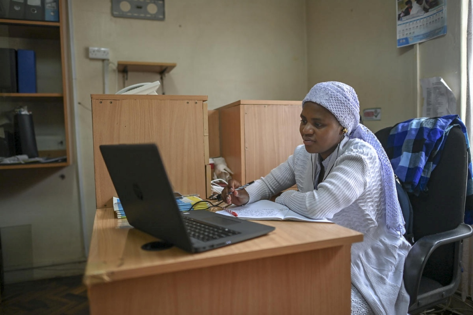 Stateless Shona woman, Nosizi Reuben, attends a virtual lecture at the Kenya Human Rights Commission office in Nairobi, Kenya.