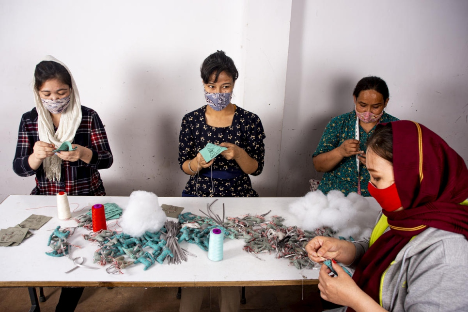 (L-R) Nasima, Shakeba, Humaira and Rowina, Afghan refugees, make felt ornaments for a Made51 project at the social enterprise, SilaiWali, New Delhi, India.