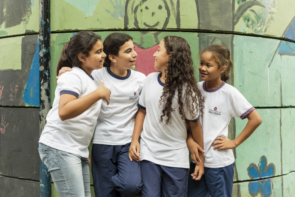 Syrian refugee Hanan Dacka, 12 years-old (2nd from left), plays with newly-made Brazilian friends (left - right) Julia Vanderlei, 12, Andessa Rabasco, 12, and Maria Luiza Sousa, 12, outside their classroom at the Duque de Caxias Municipal School in the Glicerio neighborhood of downtown Sao Paulo in Brazil.