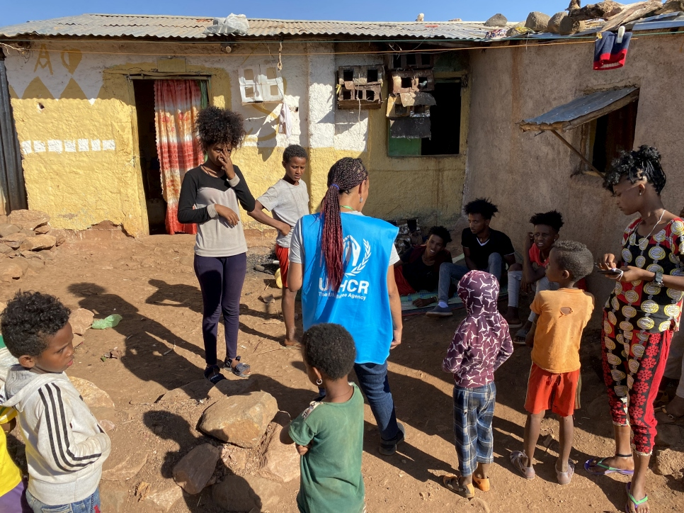 A UNHCR officer talks to refugees in Mai Aini refugee camp. The biggest concerns of the refugees are food, clean water, and the security situation in the camps. The refugees report almost nightly looting by armed gangs.