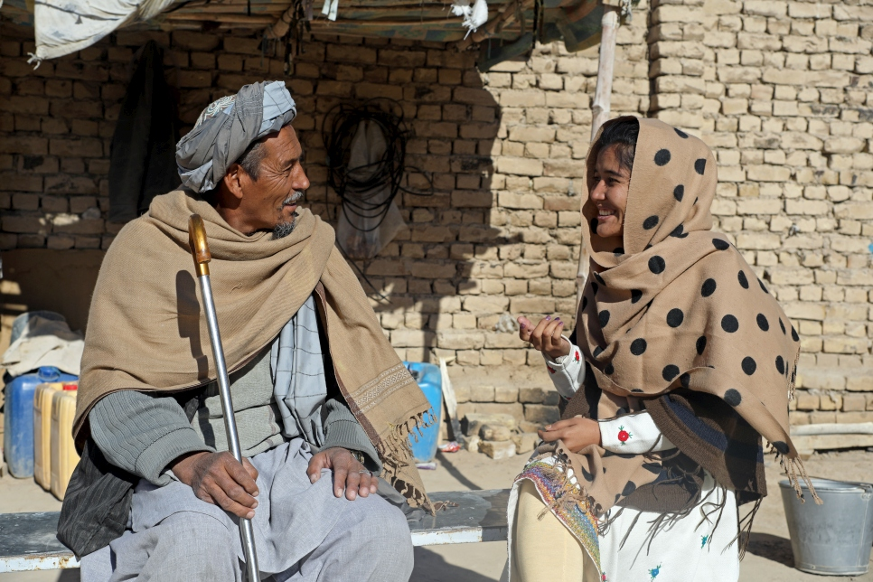Mahbooba Afghan with her father at their family home in Quetta, Pakistan.