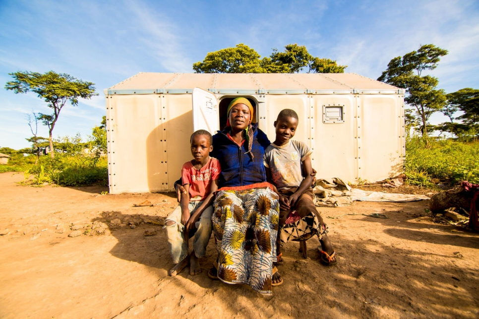 Burundian refugee Velarie Ntahonicaye and her family pose outside their home in Kigoma Refugee Camp, Tanzania, April 2019.