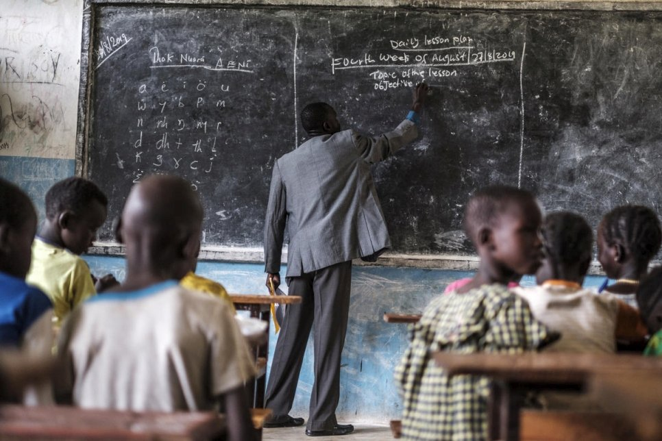 """Fewer girls go to school here because of early marriage. Sometimes their family situation forces girls to stay at home to prepare food or make tea to sell.""