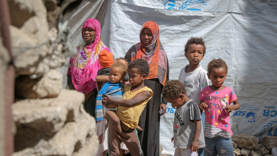 Displaced Yemeni mother, Gabra (in pink) and her family, in a hosting site in Sana'a.