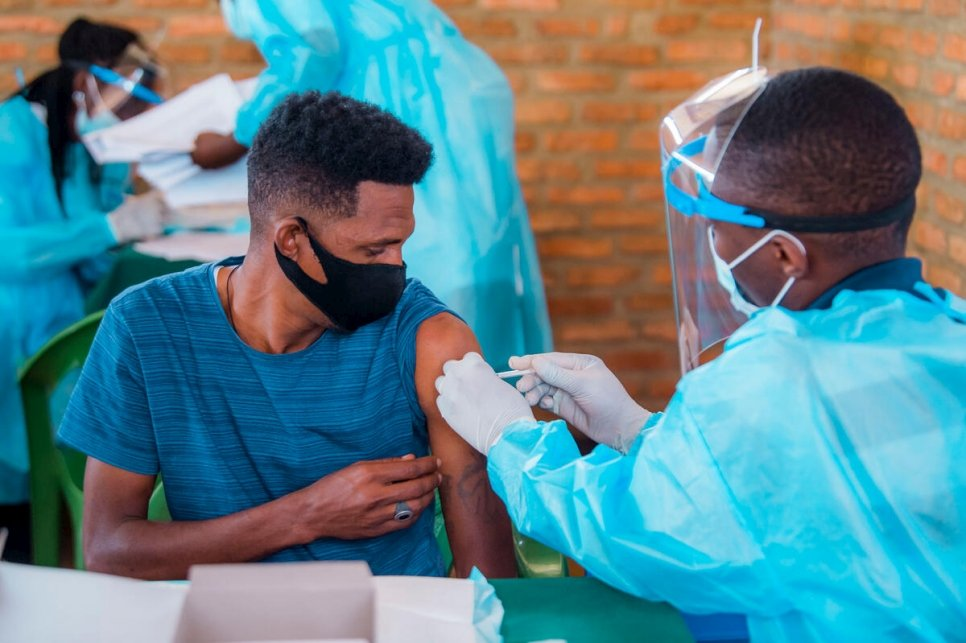 A refugee receives his COVID-19 vaccination at the Gashora Emergency Transit Mechanism centre in Rwanda.