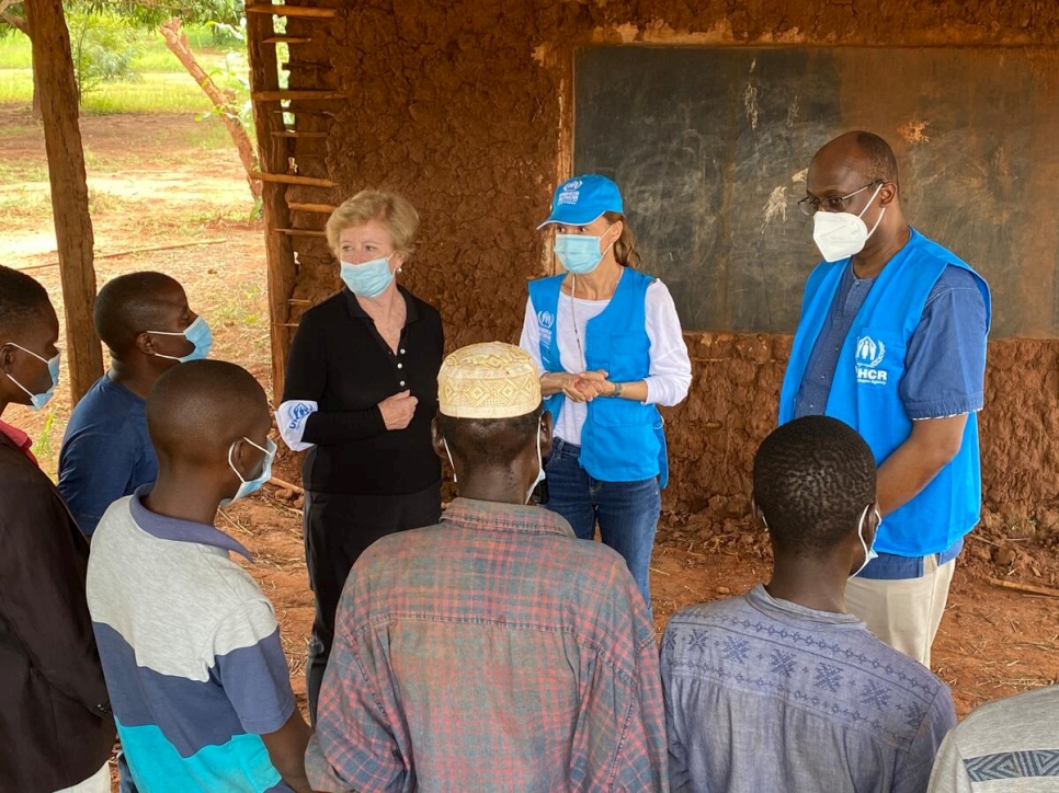 UNHCR representatives (left to right) Assistant High Commissioner for Protection, Gillian Triggs, Head of Field Office in Pemba, Margarida Loureiro, and Assistant High Commissioner for Operations, Raouf Mazou, talk to teachers at a school that received UNHCR tarpaulins for roofing at the Nanjua B internally displaced persons relocation site, in the district of Ancuabe, Cabo Delgado, northern Mozambique.