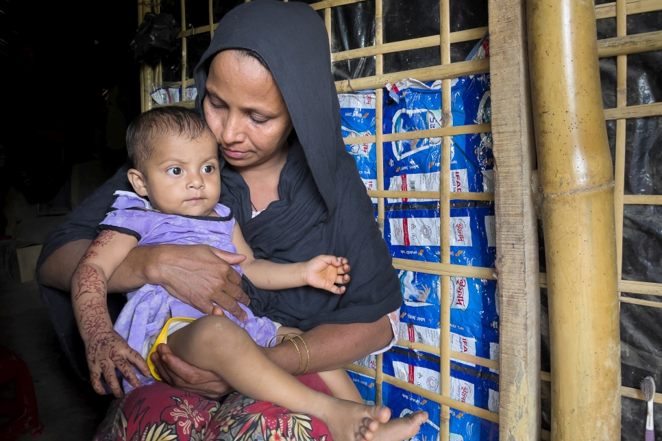 Bangladesh. Rohingya woman took shelter in her relative's home after losing everything in a recent fire at Kutupalong refugee settlement.