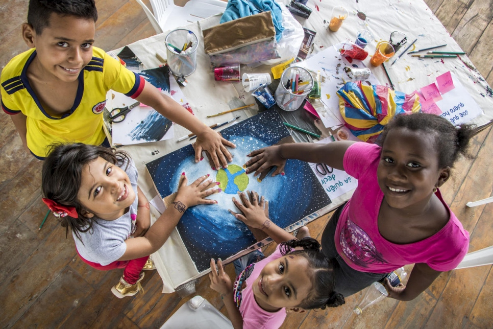 Young refugees and locals paint together in Ecuador