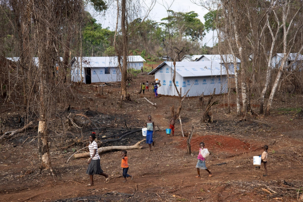 People walk within a section of Modale site in northern Democratic Republic of the Congo, where UNHCR is relocating Central African refugees from the border area.