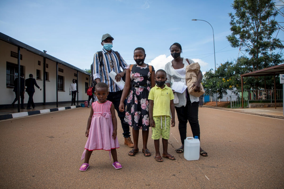 Donatien stands with his family at the border crossing in Kirundo Province, Burundi.