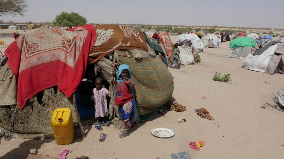 Chad. Two kids standing in a hut in Forkolom internal displaced persons' camp, near Lake Chad