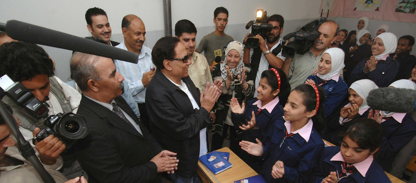 Syria / Adel Imam, UNHCR Goodwill Ambassador talks with  Iraqi refugee children at a school in Saida Zeinab on his two day visit to Damascus, Syria. / UNHCR / J. Wreford / 12 September 2007