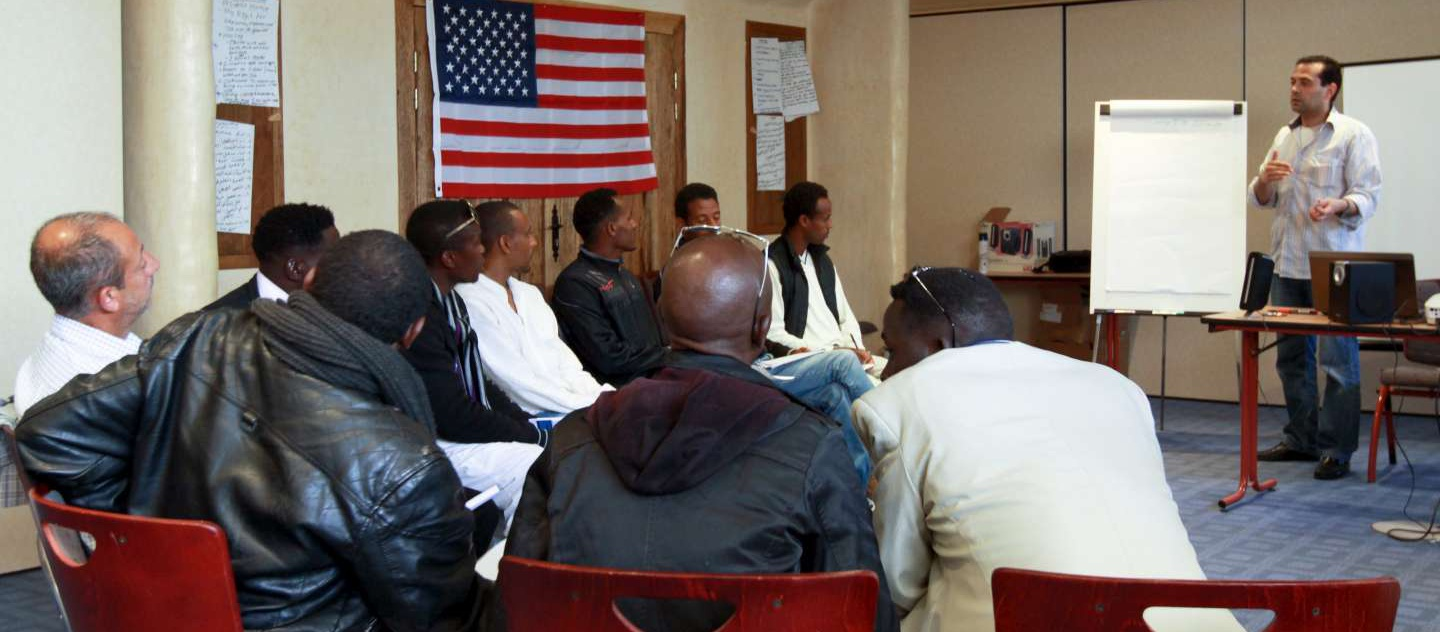 A group of refugees from Somalia, Eritrea, Ethiopia, Sudan, Ethiopia, Iraq and Liberia attend a cultural orientation session with the International Organization for Migration before being resettled in the United States.