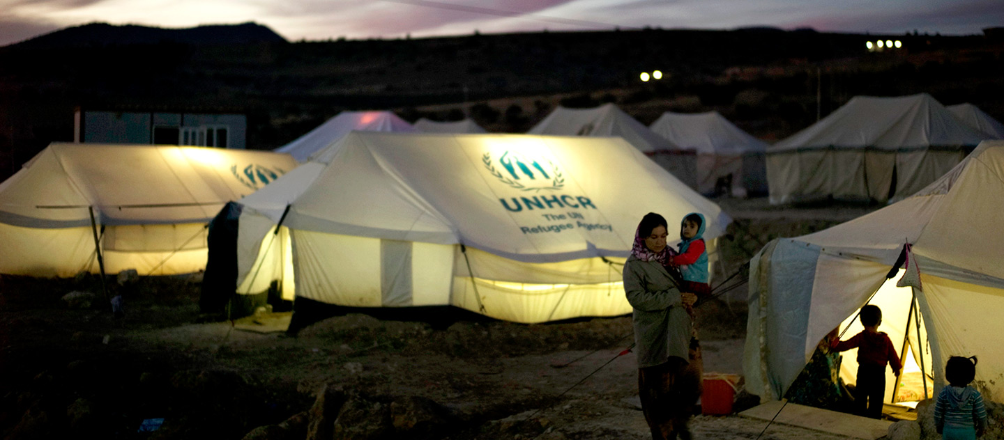 IDP's prepare for dinner next to UNHCR tents are lit from within after the sun has set in Zozan City IDP camp in Dohuk. Nights are already cold with temperatures can easily go below approximately 5C. In the coming weeks temperatures will drop below zero degrees.