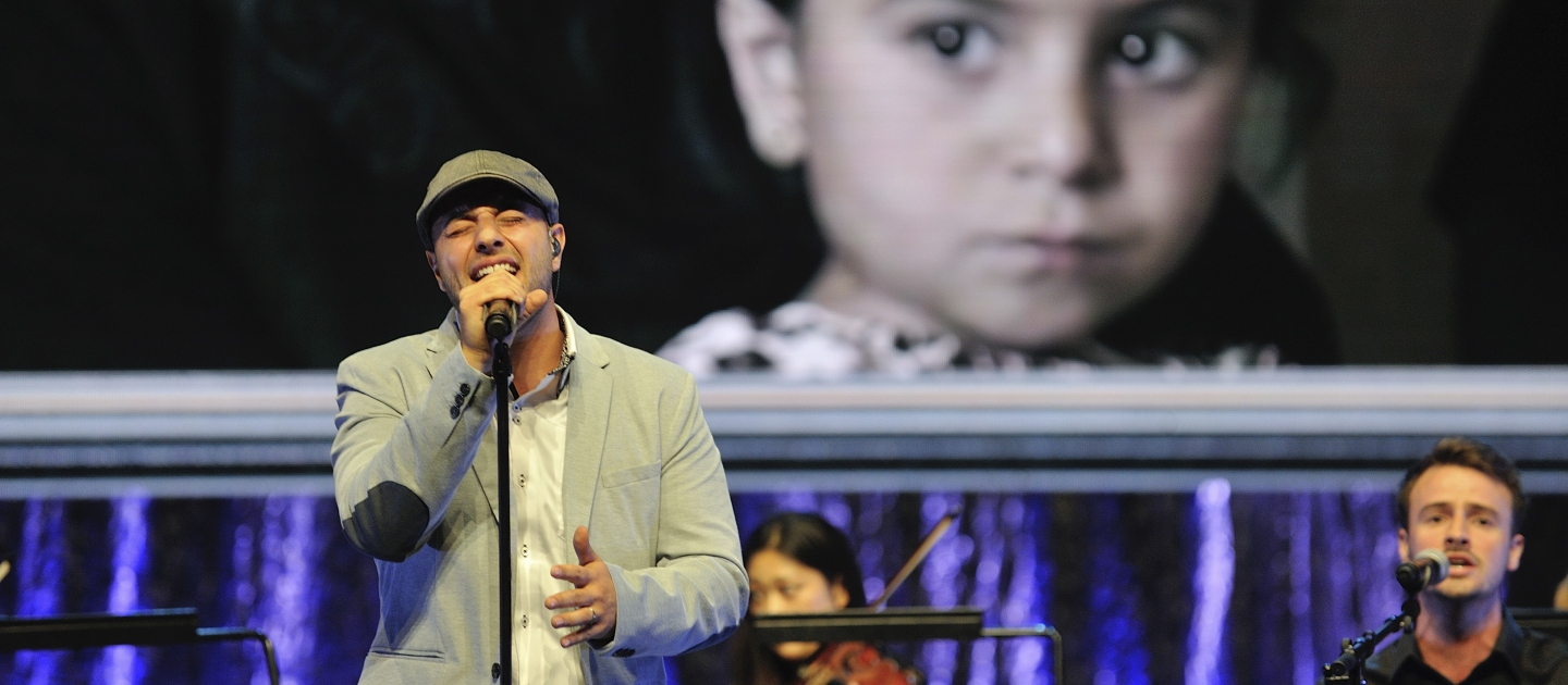 Switzerland / Swedish-Lebanese singer-songwriter Maher Zain performs a new song entitled 'One Day' at the Nansen Refugee Award ceremony. Maher recently visited Lebanon with UNHCR to meet Syrian refugees.a 'One Day' was inspired by those he met and the millions of other forcibly displaced around the world. UNHCR / M. Henley / September 2014