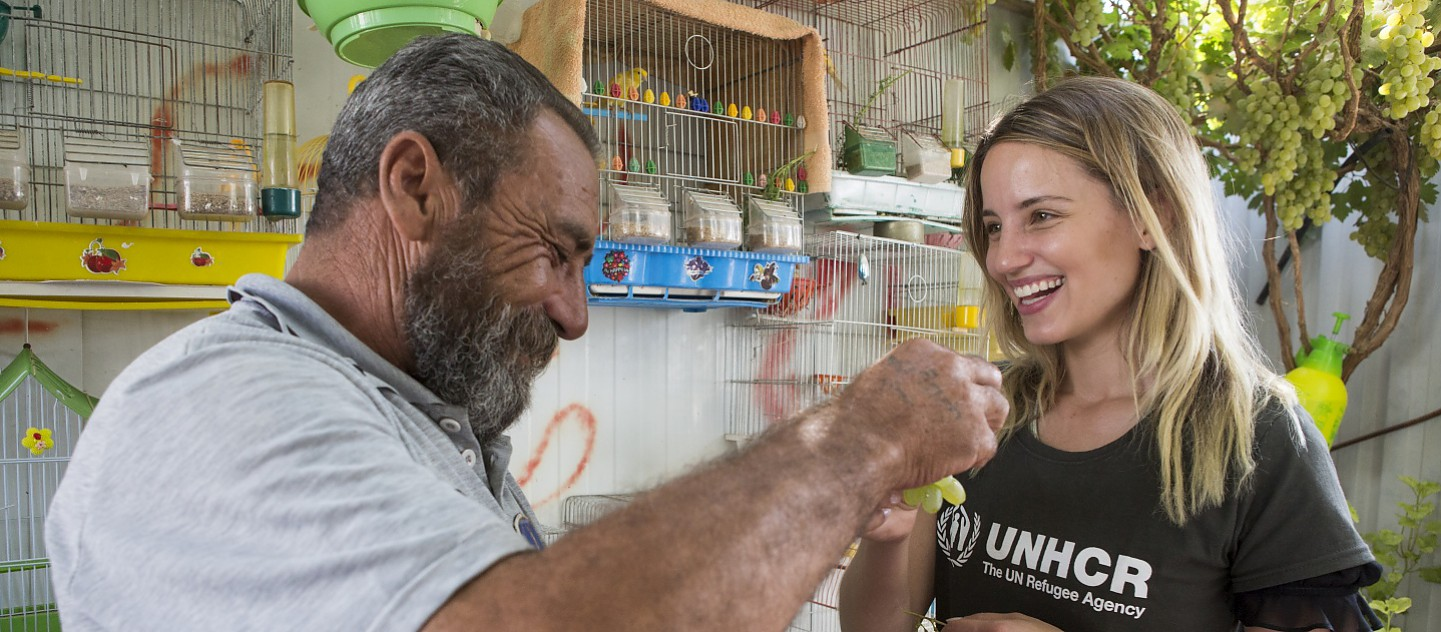 UNHCR High Profile Supporter Dianna Agron meets Syrian refugee Abu Aham who lives in Zaatari refugee camp (Jordan) with his wife and their 15 year old son, 2 widowed daughters-in-law, and 5 grandchildren. Their 2 eldest sons were killed in Syria.