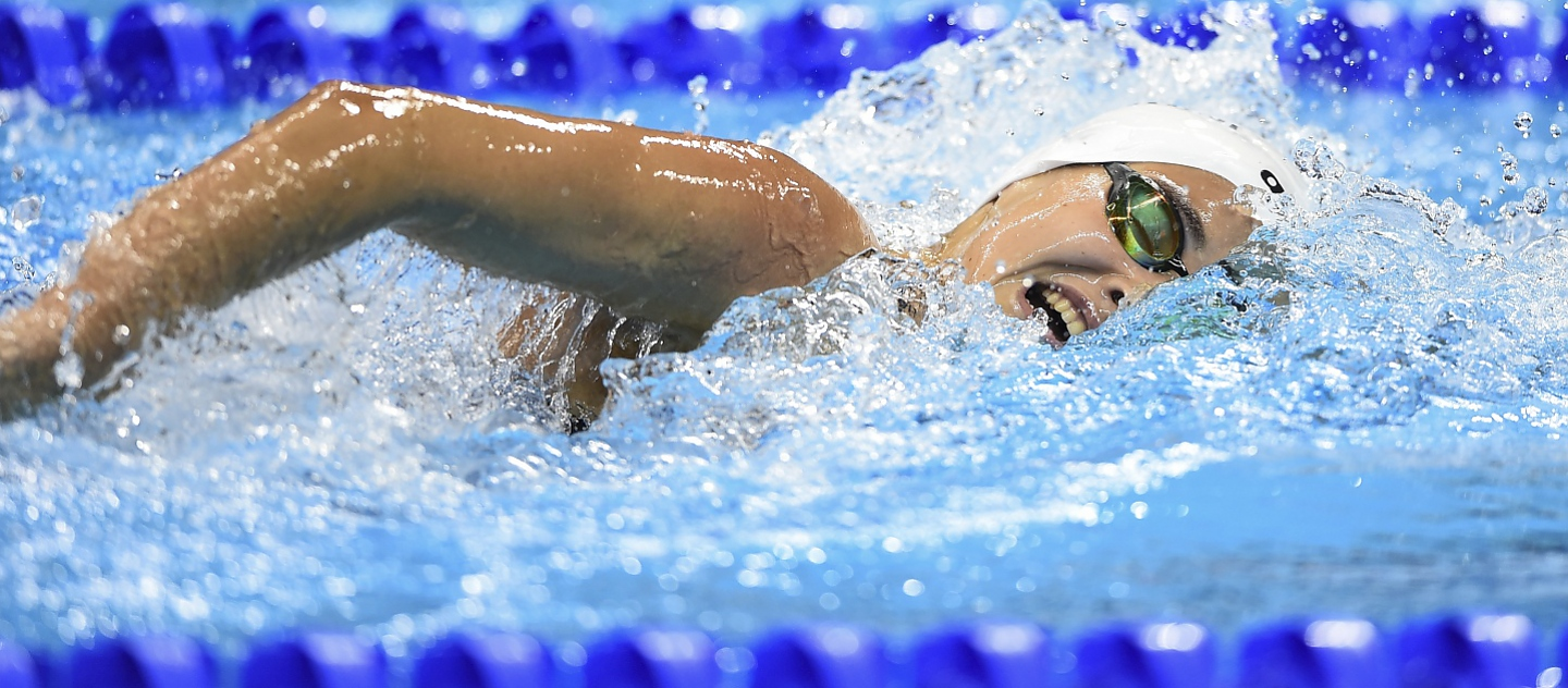 Yusra Mardini, an 18-year-old swimmer who fled the war in Syria, glides through the water in her last race of the 2016 Games