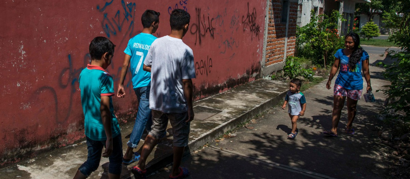 Young refugees from El Salvador head off to play street football in their adopted city of Tapachula, southwest Mexico, close to the border with Guatemala, in this September 2016 file photo.