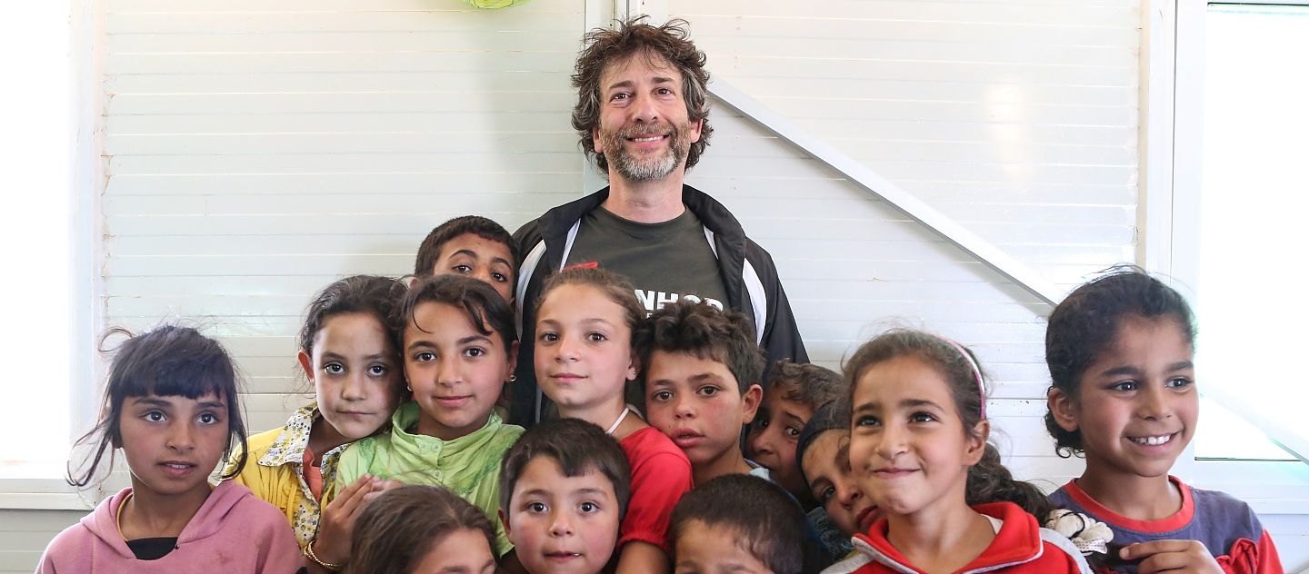 UNHCR Goodwill Ambassador Neil Gaiman meets children at playgroup in Azraq refugee camp.