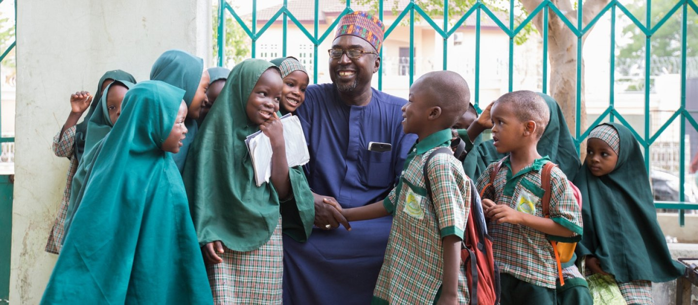 Mustapha and the students of Future Prowess Islamic Foundation School before morning assembly.