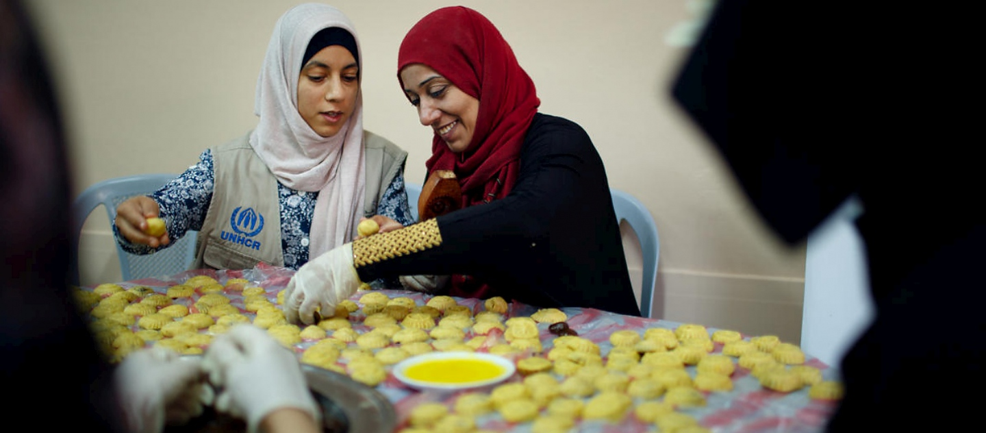 Jordan. A group of refugee women make sweets for Eid and distribute to needy families
