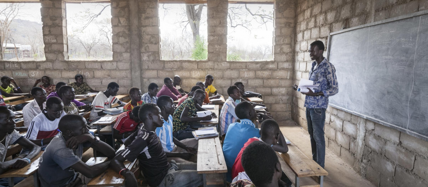 South Sudanese teacher Lim Bol teaches at a primary school in Kule refugee camp, Ethiopia, March 2016.