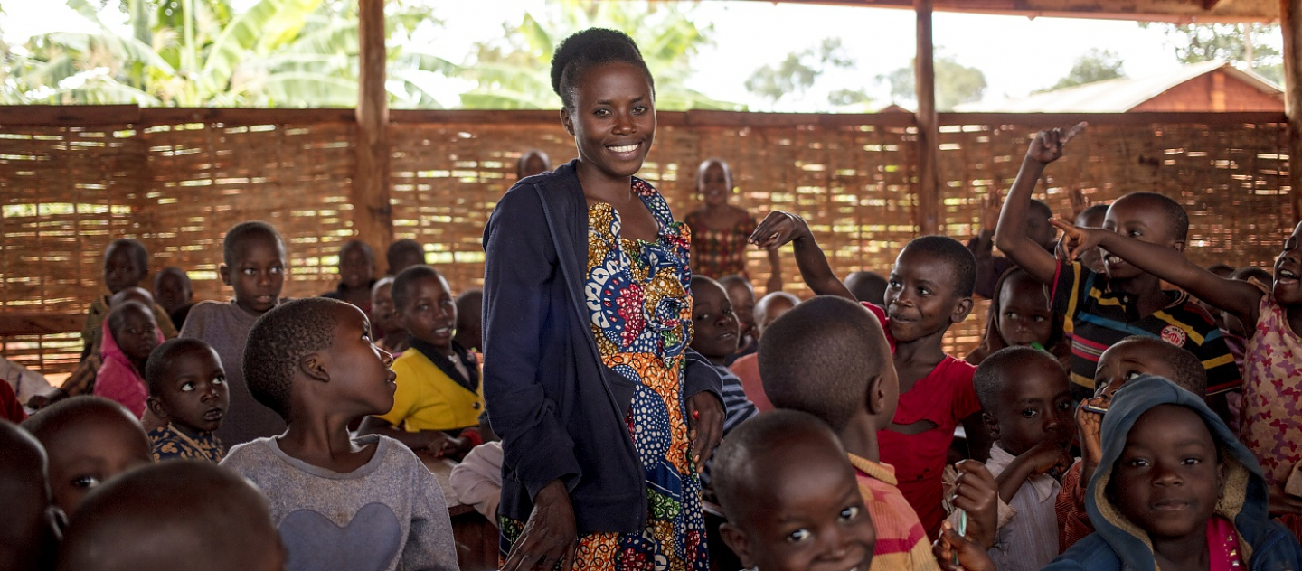 Burundian refugee teacher Nimbona Valyne, 26, teaches Kirundi to pupils at Jugudi Primary School in Nyarugusu Refugee Camp, Kigoma Province, western Tanzania. There are 68 boys and 44 girls in Nimbona's class.